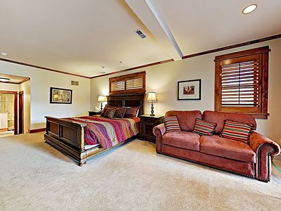 Master bedroom suite is entire ground floor - king bed, ensuite bath, fireplace