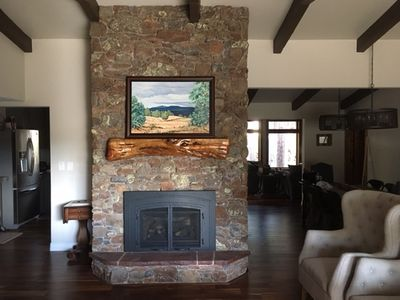 Natural stone gas fireplace in living room