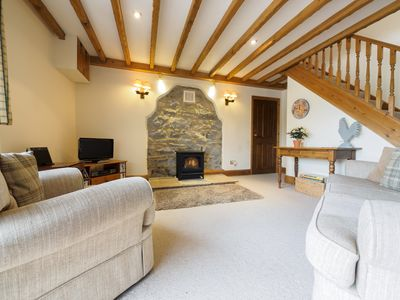 Cosy lounge with feature fireplace