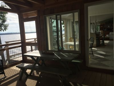 Picnic table on screened porch for meals and card games! Next to the kitchen.
