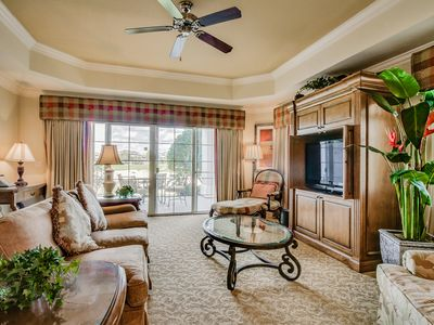 Photo for Luxurious condo with access to shared resort pools, hot tub, game rooms, & more!