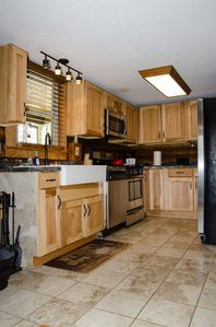New hickory Cabinets, ceramic tile, and SS Appliances including dishwasher