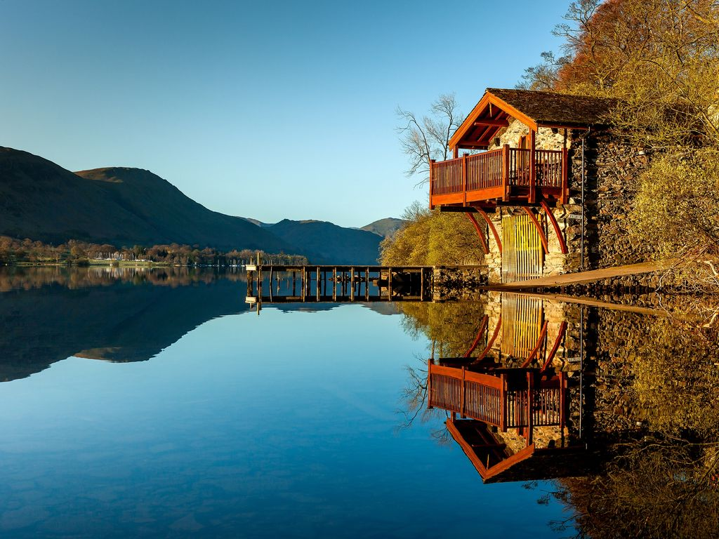 Log Cabin On Shores Of Lake Windermere Surrounded By
