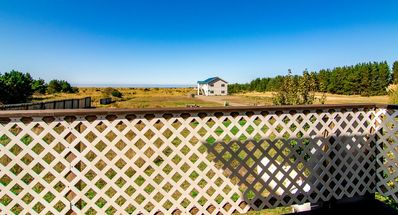 Surfview 3 sleeps 15 people in 7 bedrooms. Front deck has a distant oceanview. Surfview 2 on the right and sleeps 12.