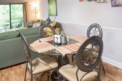 Dining Area - Share home-cooked meals at a glass-top dining table for 4.