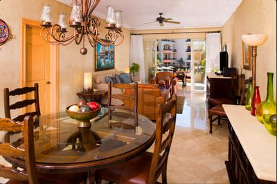 Dining room, living room and balcony.