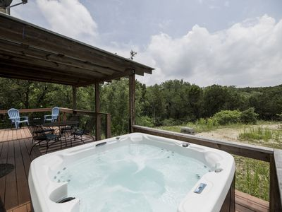 Photo for Adorable country cottage overlooking a wet weather creek with hot tub