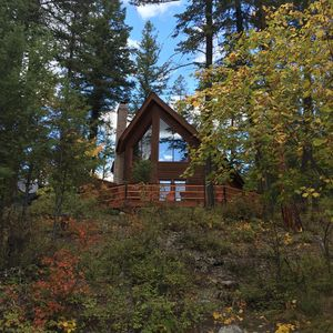 Private Whitefish, Montana Cabin in wooded area with private beach access.