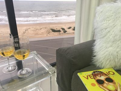 Enjoy a glass of wine while looking at the beach.