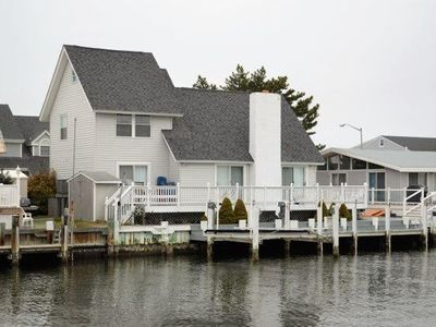 Photo for WATERFRONT/PRIVATE DOCK, GORGEOUS INSIDE AND NEAR BEACH