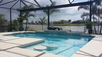Waterfront, West facing with Large Pool & Lanai in South Gulf Cove