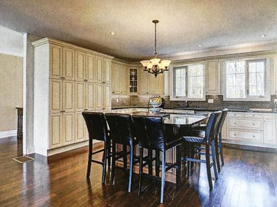 View into the kitchen from the living room.  Black granite countertops