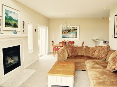 Photo for Oasis away from home! Easy walk to beach or town. Marina views & private pool.