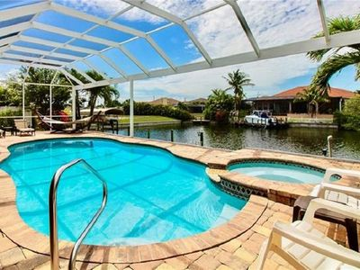 Photo for On canal with heated pool and spa in popular SW Cape Coral
