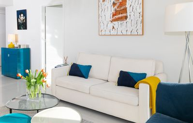 Original paintings, queen-size sofa, great city views.