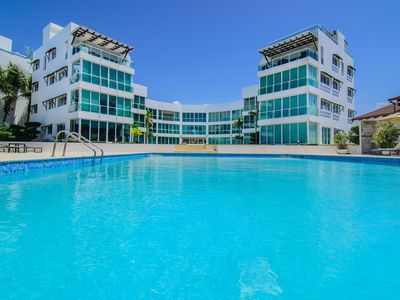 Photo for 2-BD condo on private sandy beach, pool, fully furnished and equipped