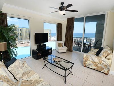 Photo for Expansive corner condo ! Stunning sunrise views! Free Wi-Fi. Minutes to Pier Park!