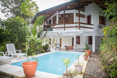 Relax in a pool surrounded by jungle at Kiskadee Casa in between adventures.