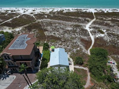 Photo for Gulf front, charming home right on the beach - stunning views & dogs welcome!