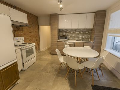 Photo for Huge 5 Bedroom apartment 2 Full Bathrooms Downtown Montreal Free parking