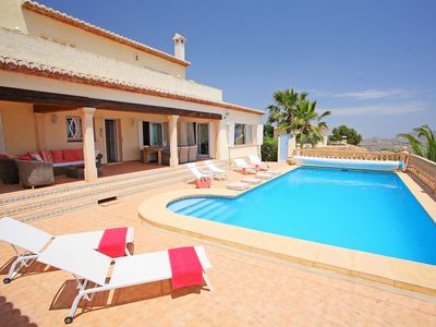 Photo for This 4-bedroom villa for up to 8 guests is located in Moraira and has a private swimming pool and Wi