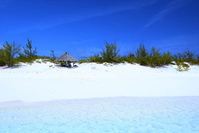 Boathouse beach and tiki hut on private 235' of white sand beach