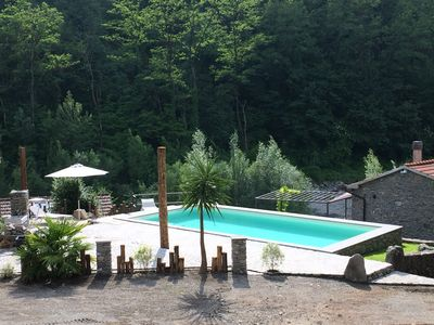 Photo for Idyllic mill on the river with pool