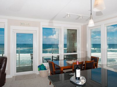 Photo for *Promo!* Third Floor Corner Condo, Oceanfront, Private Hot Tub, Pool, Free Wifi!