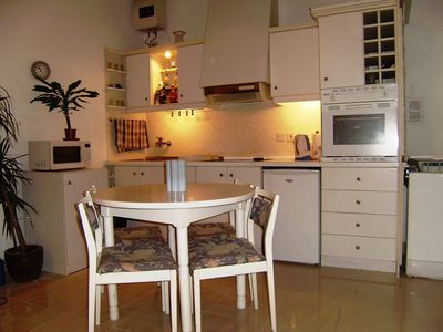 dining + fully equipped kitchen