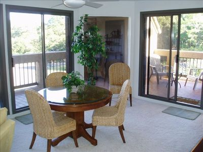Spacious dining room area with 3 sets of sliding glass doors out to large patio.