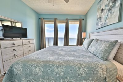 Master bedroom with large windows with views of the Gulf