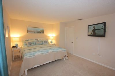 Wind down after a Fun Filled day in this Lovely Master Bedroom with King Bed, and Flat Screen TV, Private Master Bathroom