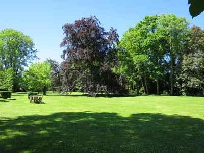 3 acres of lush gardens and century-old trees