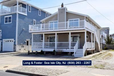 Photo for Beachblock condo. Close to the beach and promenade.  Nice front deck. Off street parking.