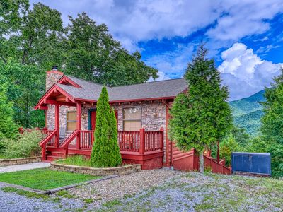 Photo for Secluded cabin w/ shared seasonal pool, wood-burning fireplace & stunning views