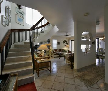 Living room viewed from the entrance with winding stair to the 3 bedrooms.