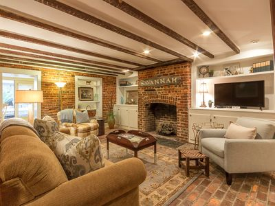 Southern Belle Garden Living Room with exposed beams and exposed brick walls and large Flat Screen TV