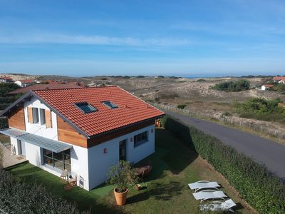 Photo for Contemporary beach villa - at the foot of the dunes and surf beaches