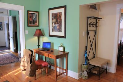 Opposite corner of the living room with working desk and chair.
