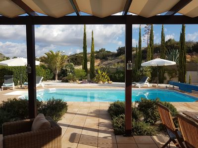 Photo for Spacious executive quality villa with pool and landscaped gardens.