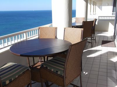 Balcony, two tables and chairs