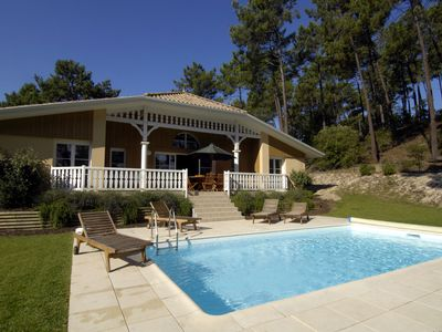 Photo for Superb detached villa with large garden and private pool next to golf course