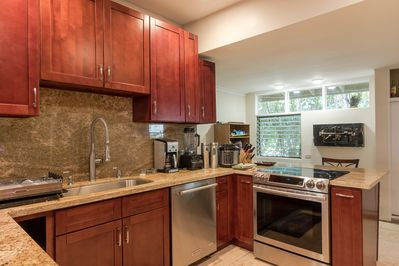 Kitchen has cookware, plates, silverware, and many extras