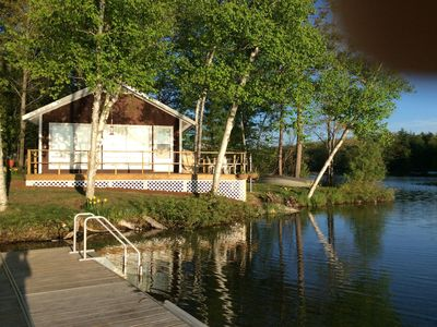 Photo for COZY SPIDER LAKE COTTAGE  Traverse City 15 min. BOOK FOR 2019 NOW.