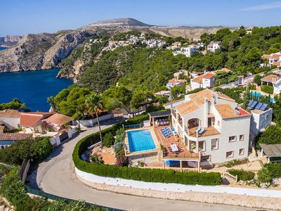 Photo for Luxury villa, stunning sea views, 7bed/6bath,12-19guests, WiFi, AC, heated Pool