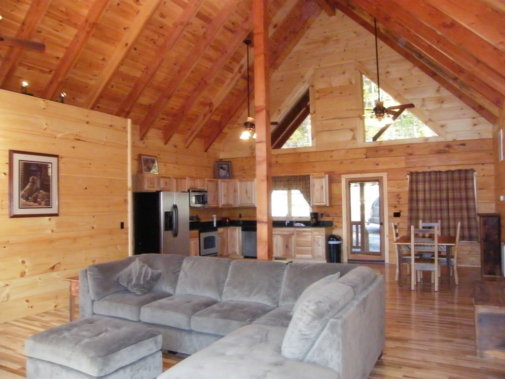 Great Room With Exposed Beams, Hickory Floors And A Nice Sectional Sofa To  Relax
