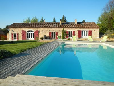 Photo for Lovely long farmhouse sleeps 14 with large pool in the heart of the Périgord