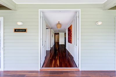 The front door leading into large open hallway