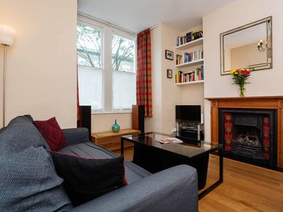 Photo for 10 minute walk to Finsbury Park Station! Lovely 4 bed home with garden (Veeve)