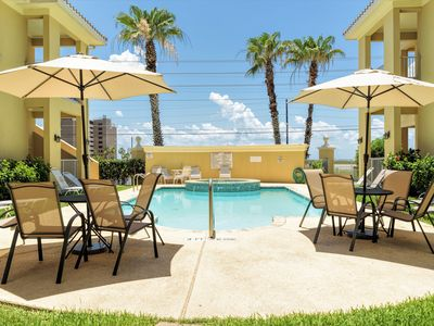 Photo for Poolside condo only 1 block from the beach!